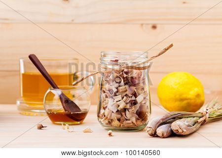 Cup Of Herbal Tea With Dried Lemon Grass ,honey And Lemon On Wooden Background.