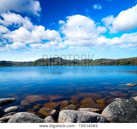 Blue Lake Idill Under Cloudy Sky