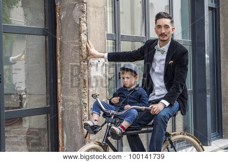 Father And Son On The Bicycle