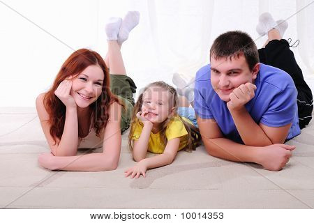 Mother, A Young Father And Young Daughter