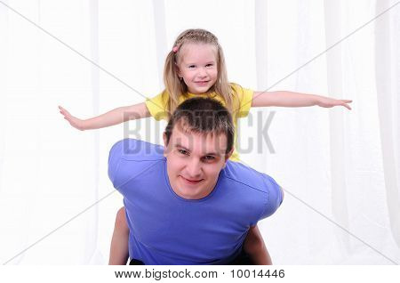 Young Father Has Fun With His Daughter