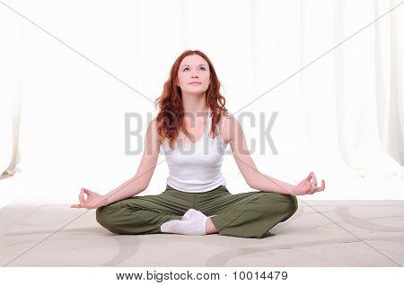 Young Girl Doing Yoga Exercises