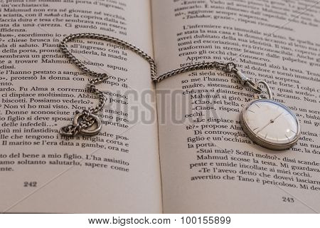 clock on opened book