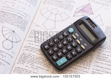 opened book and calculator