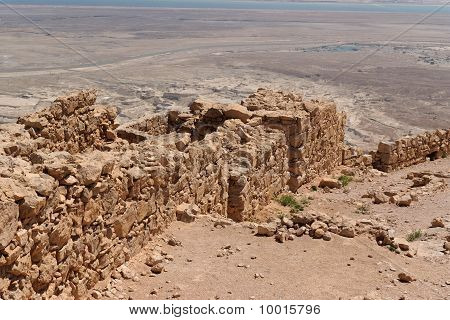 Ruined wall of ancient fortress in the desert