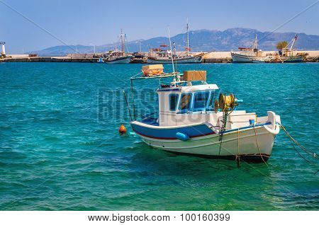 Blue-white boat floating on clear water, Greece