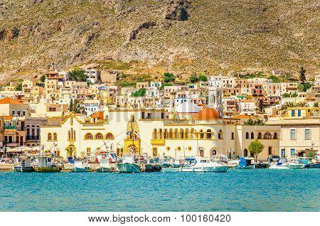 Pothia city and red townhall on Kaylmnos, Greece