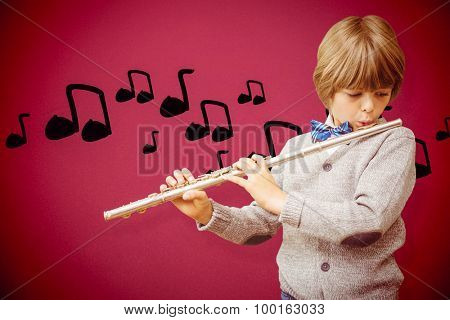 Cute pupil playing flute against red background
