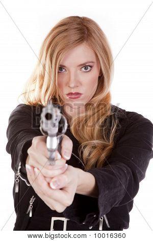Blond Looking Down A Gun