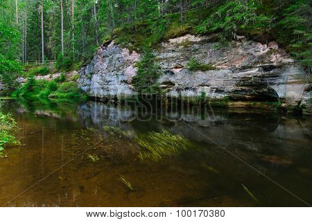 Sandstone Outcrops Reflection On Water Of Ahja River, Estonia