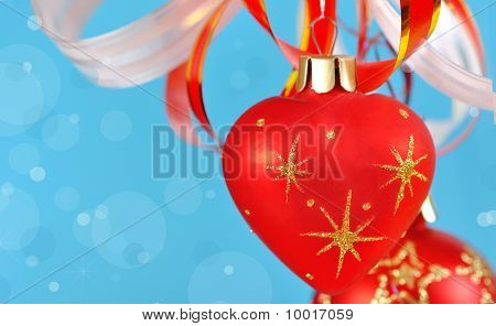 Christmas Balls On A Blue Background And Abstract Bokeh With  Space