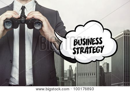 Business strategy text on speech bubble with businessman holding binoculars