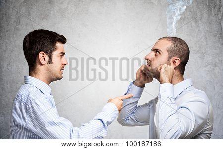 Businessman scolding a colleague