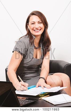 Smiling woman subscribing document