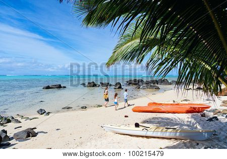 Mother and kids family at tropical beach on Rarotonga island, Cook Islands, South Pacific