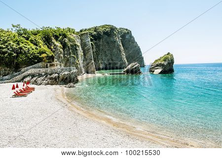 The Beach And The Cliffs On The Island Of St. Nicholas In Budva, Montenegro
