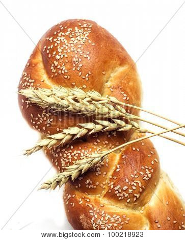 fresh bread and ears of wheat, isolated against white background