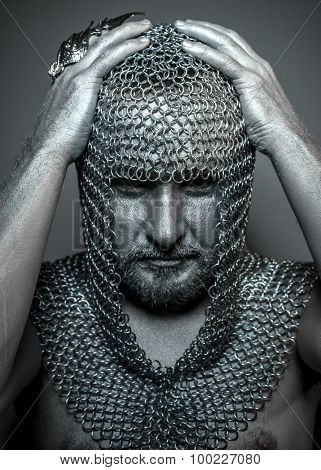 Hooded, medieval executioner mesh iron rings on the head