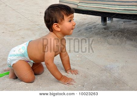 Cute Baby Boy On The Sand