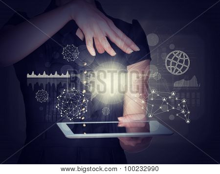 Businesslady with tablet and graphs