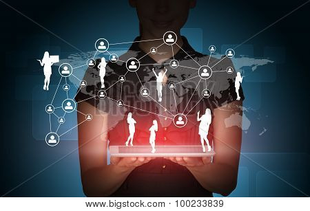 Businesslady with tablet and peoples silhouette