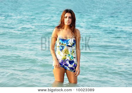 Young Beautiful Woman In Sea At Sunset