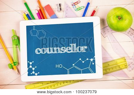 The word counsellor and science graphic against students desk with tablet pc