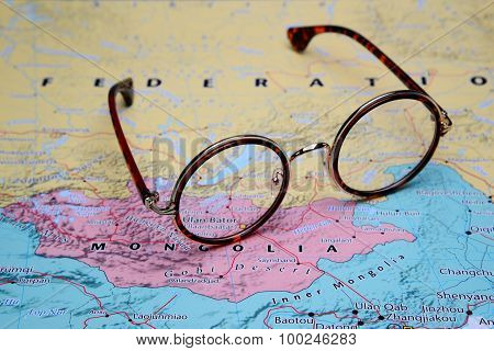 Glasses on a map of Asia - Ulan Bator