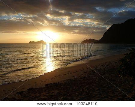 Early Morning Sunrise On Waimanalo Beach Over Rabbit Island Bursting Through The Clouds