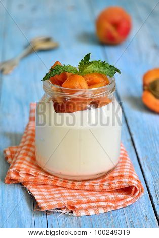 Greek Yogurt With Apricoits In The Jar.