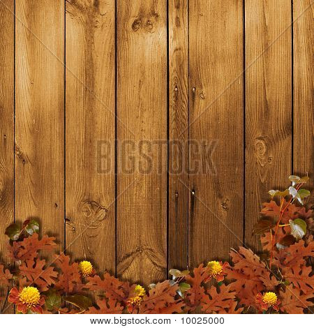 Card For The Holiday  With Autumn Leaves On The Wooden  Background