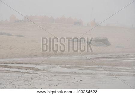 Beach under the morning fog