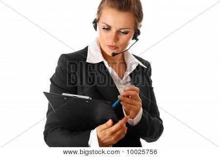 worried modern business woman with headset and clipboard