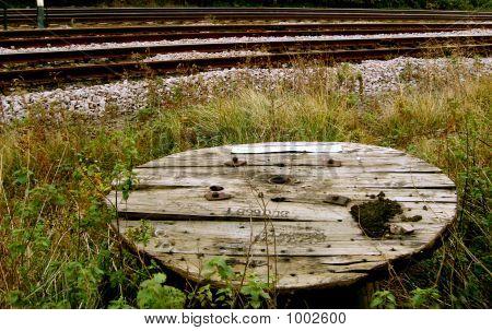 A Wire Spool Beside Railway Tracks