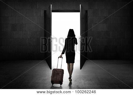 Back View Of Business Woman Standing Toward Door