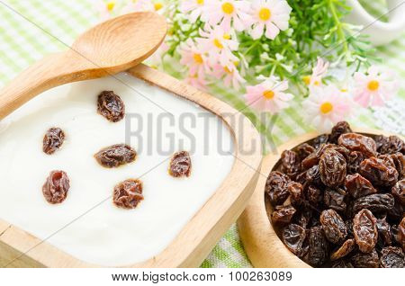 Home Sweet Yogurt With Raisins In A Wooden Bowl With Fower.