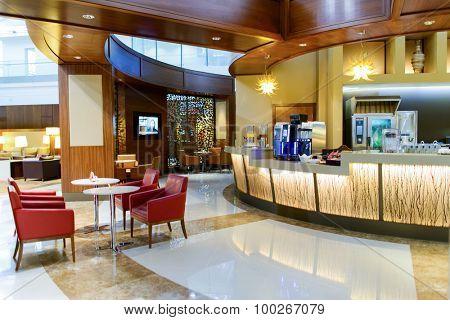 DUBAI, UAE - APRIL 18, 2014: business class lounge interior. Dubai International Airport is an international airport serving Dubai.