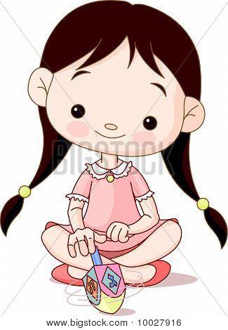 Cute Little Girl Spinning Dreidel