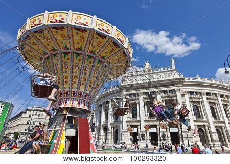 Beautiful View Of The Historic Burgtheater With Some People Enjoy A Ride On A Carousel