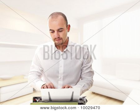 Man With Typewriter At Home