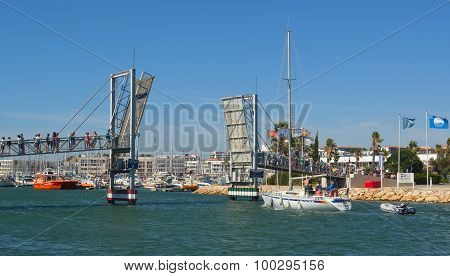 Bridge being lifted for yacht to pass under