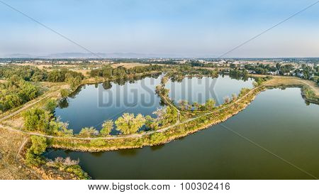 aerial panorama view of Riverbend Ponds, one of natural areas in Fort Collins, Colorado along the Poudre River converted from gravel quarry for recreation