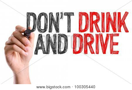 Hand with marker writing the word Don't Drink and Drive