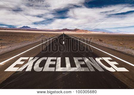 Excellence written on desert road
