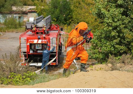Orel, Russia - August 28, 2015: Russian Emergency Control Fireman In Orange Uniform Ready To Put Out