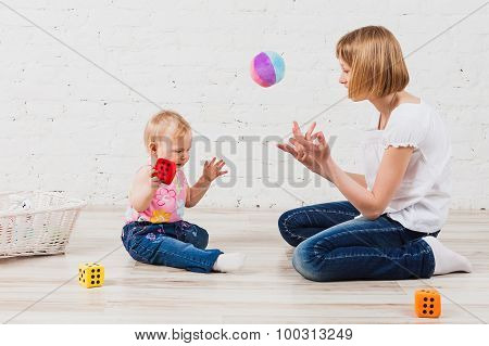 girl playing with her baby sister