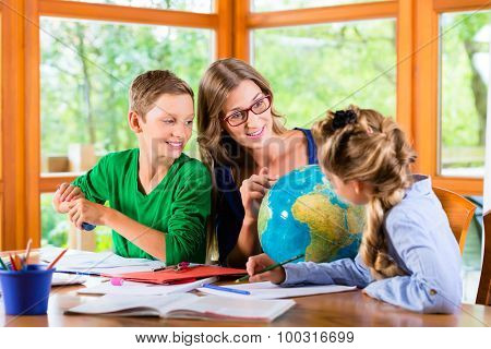 Homeschooling mother teaching kids private lessons in geography poster