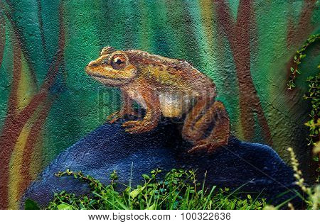 Big brown fairy-tale toad sitting on stone in grass, acryl painting