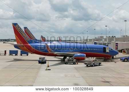 ATLANTA, GEORGIA-AUGUST 20, 2015: A Southwest Boeing 737-3H4 airplane at the Atlanta International Airport. Southwest Airlines has nearly 46,000 employees and operates more than 3,400 flights per day.