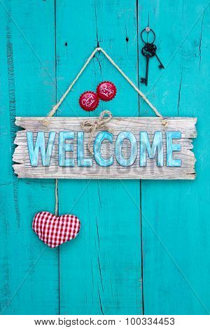 Welcome sign with heart and keys hanging on rustic wood door